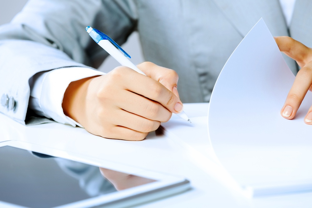 Man signing the paperwork to form a LLC