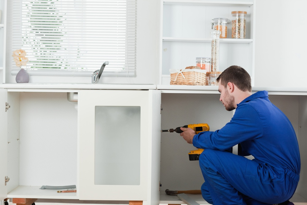 An effect contractor performing repairs on a home